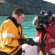 The image of James Bond stepping out of a wet suit with a dry tuxedo underneath became a reality for enthuse client Akaroa dolphin swimming operator Black Cat Cruises in 22 July this year. The company is introducing a world first dolphin swimming experience - the use of dry suits which are also used by New Zealand Armed Forces, the US coast guard and the NASA space programme for Escape Suit Life preservers. The dry suits were launched with TNVZ news with television coverage including TVNZ breakfast, lunch and 6pm news. Reporter Jack Tame experienced the new dry suits first hand and said the experience was outstanding and was like swimming on the coast of Suva in Fiji.   